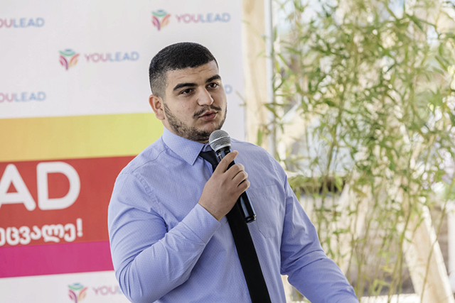 Rashan, an emerging leader in the ethnic Azerbaijani minority community in Georgia, speaking at a youth conference in April / International Republican Institute