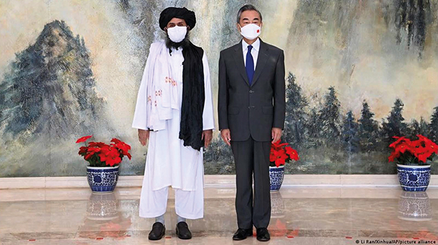 Taliban political chief Abdul Ghani Baradar and Chinese Foreign Minister Wang Yi in Tianjin, hold a meeting in China on July 28, 2021. Photo by Li Ran/Xinhua/AP