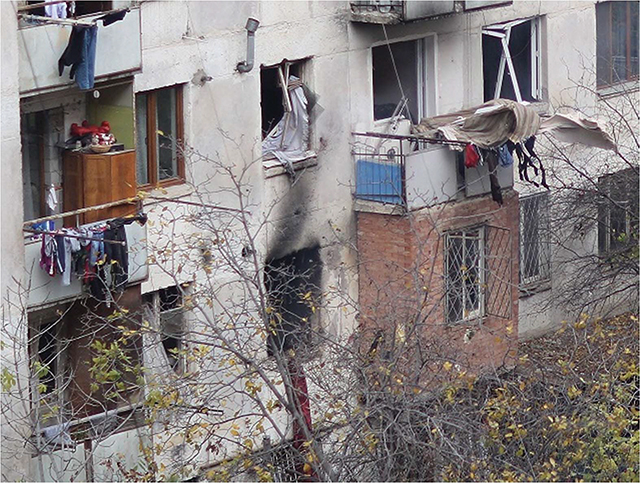 Scorch marks and bullet impacts outside of the rented flat where Akhmed Chatayev and his four fighters fought with Georgian security forces in the Isani district of Tbilisi in 2017. Source: Giorgi Abdaladze/Facebook