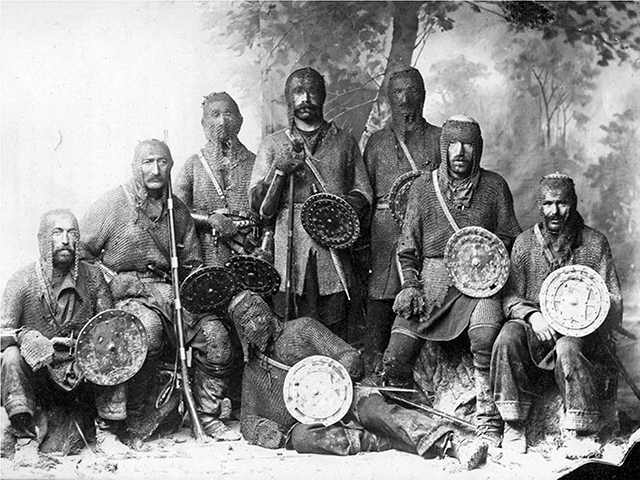 Khevsurs, in Georgian ხევსურეთი, with their traditional arms and armor gather for a photo displaying their martial prowess as mountain soldiers. Source: Photographer unknown